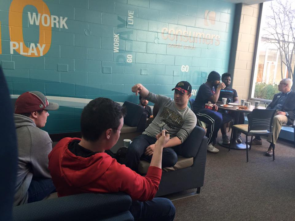 Students sitting and conversing in a lounge area