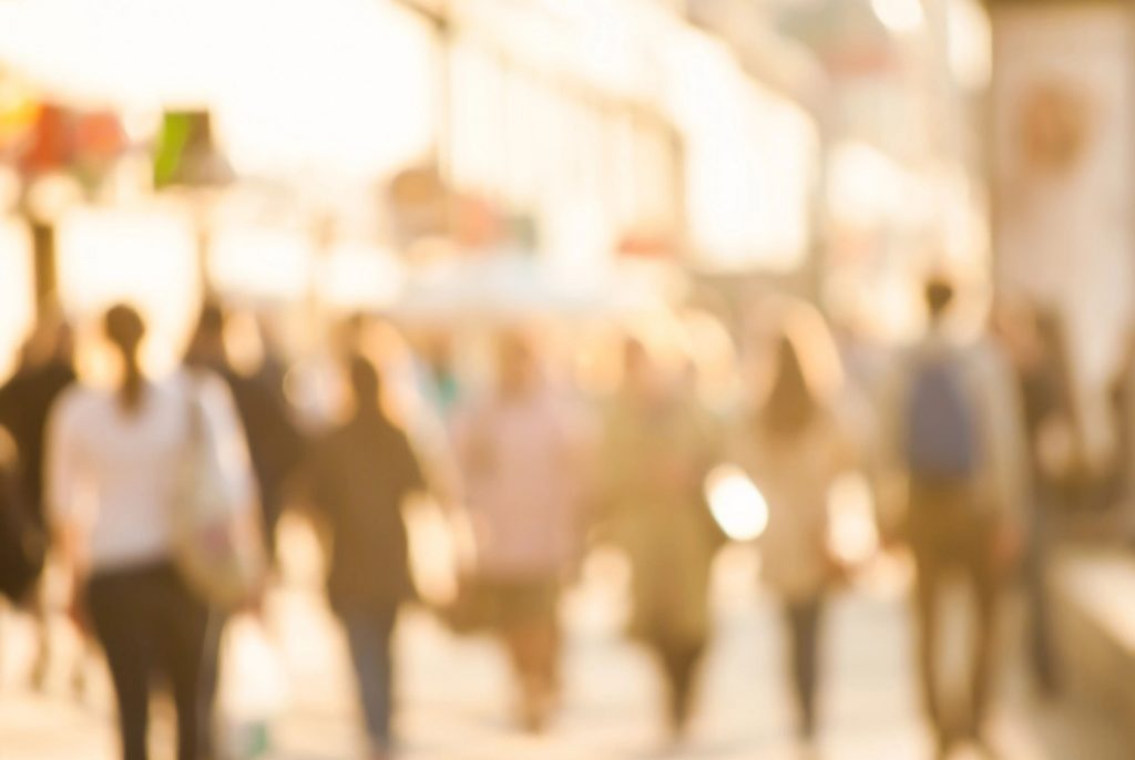 An unfocused image of people walking away from the camera