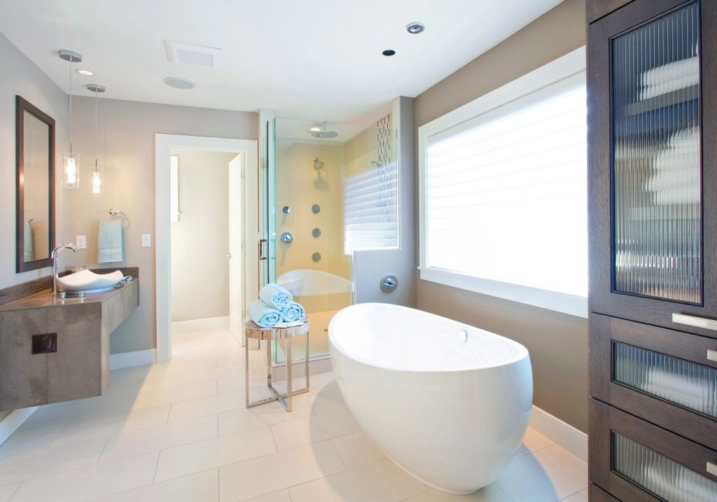 Bathroom with a freestanding tub and glass shower stall