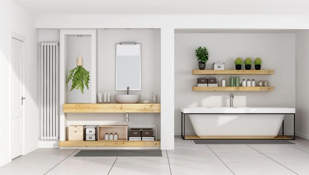 A bathroom with water basin-style sink, wood vanity and plants