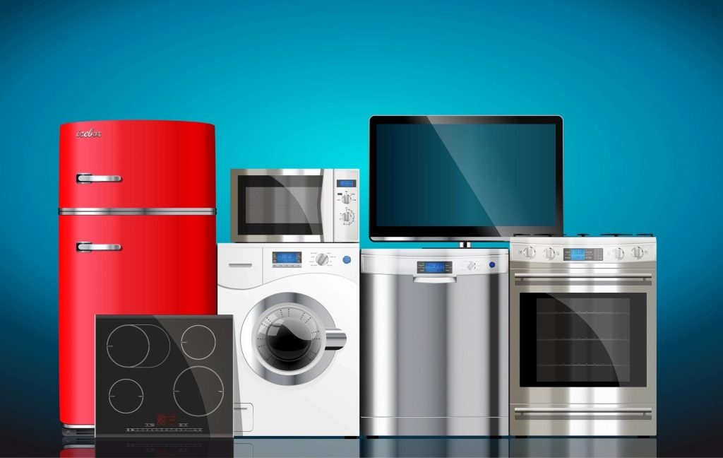 Silver and red appliances arranged in front of a blue background