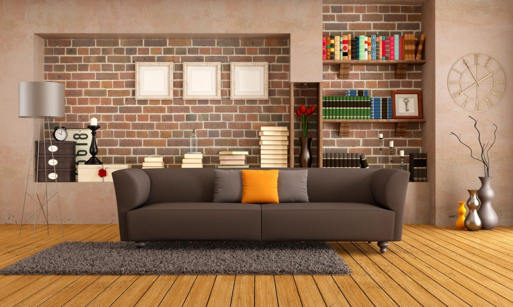 A living room with bookshelves, couch, and floor lamp