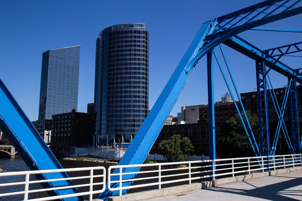 A view of a city from a bridge with blue structures on it