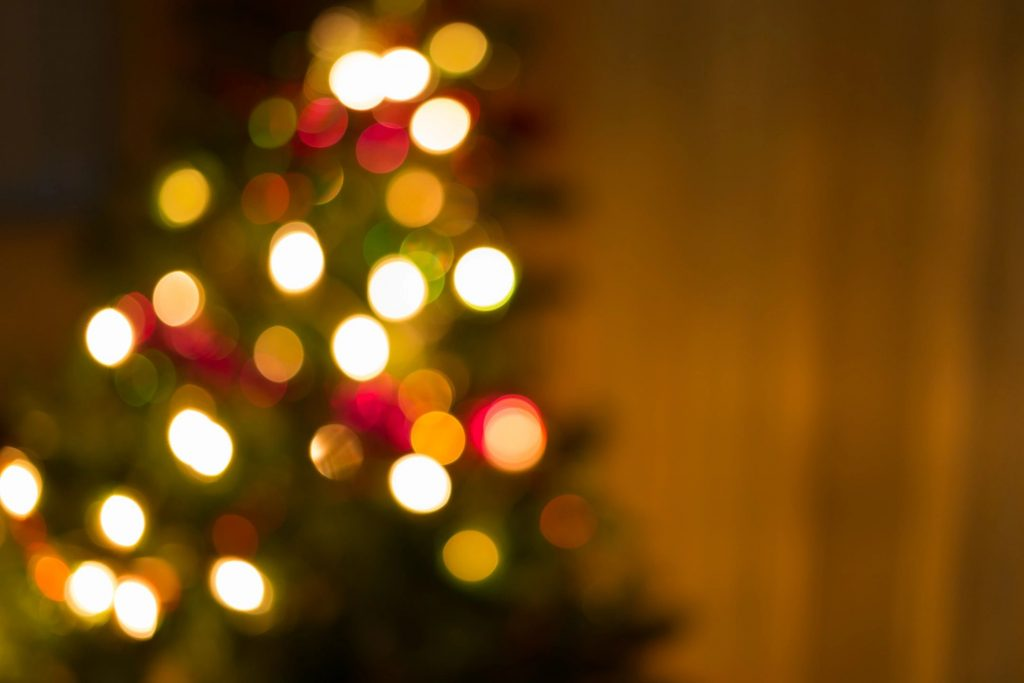 An out-of-focused photo of lights on a Christmas tree