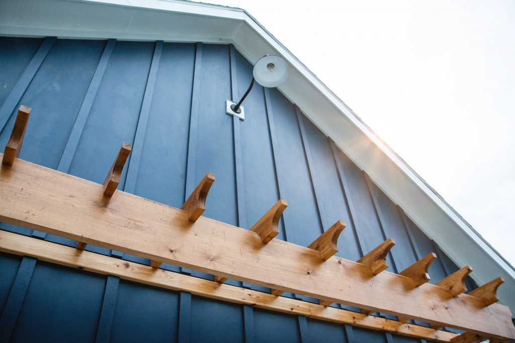 A pergola style eave on a barn-like garage