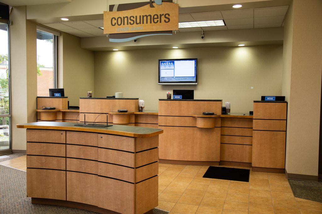A Consumers Credit Union office front desk and withdrawal and deposit kiosk