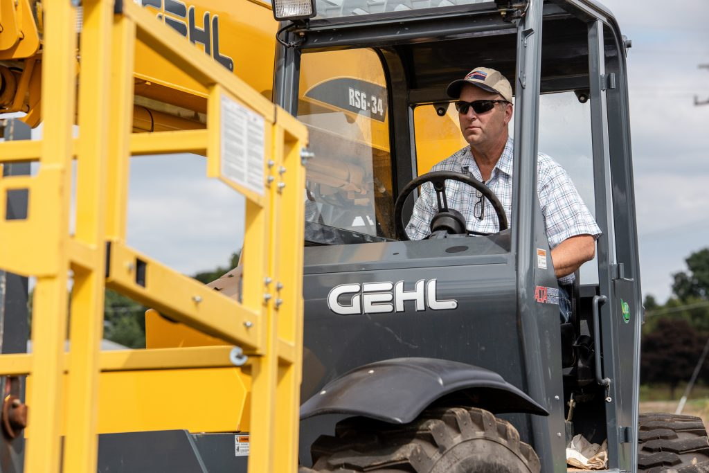 A man driving a heavy construction vehicle outdoors