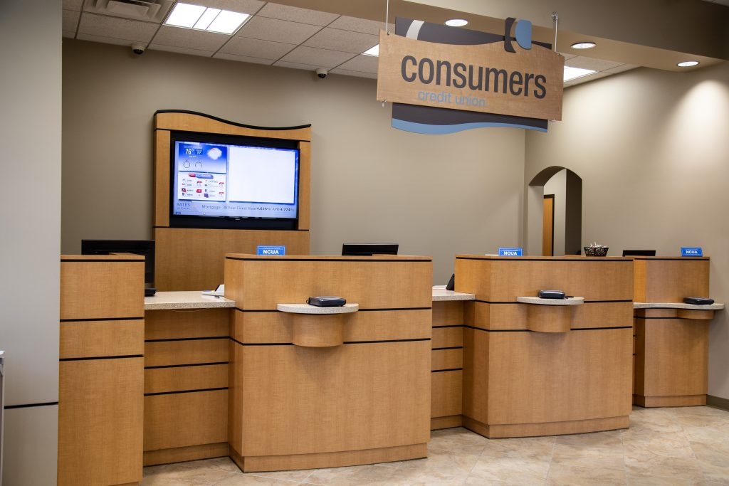 Consumers Credit Union office front desk with three bank teller windows