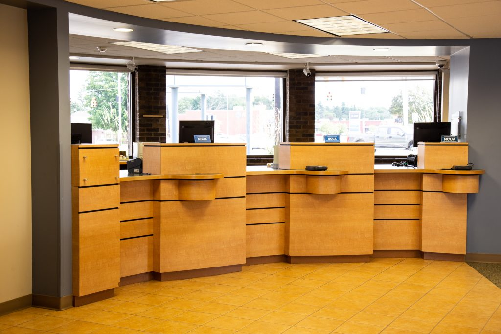 A Consumers Credit Union office location curved front desk with three bank teller windows
