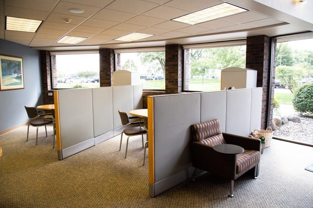 Office cubicles for financial counseling at a Consumers Credit Union office next to a waiting area