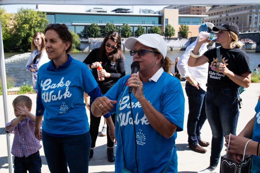 An woman speaking at a fundraising walk event