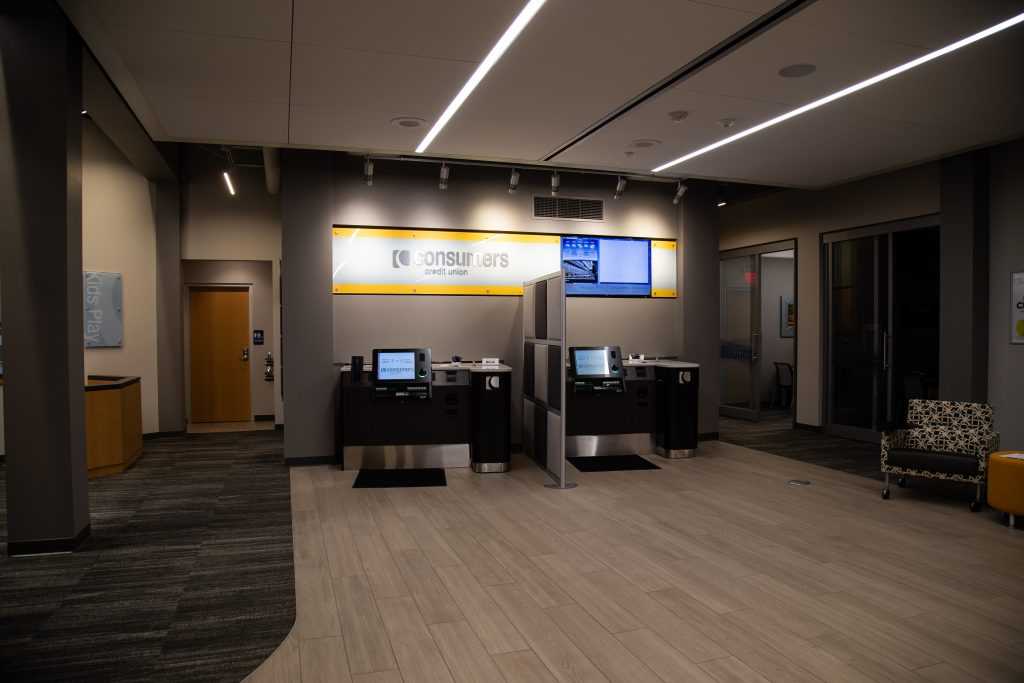 A Consumers Credit Union office lobby with two self-serve banking kiosks