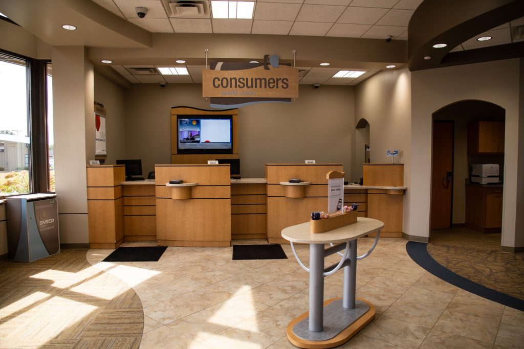 Consumers Credit Union bank teller windows with sunshine coming through windows