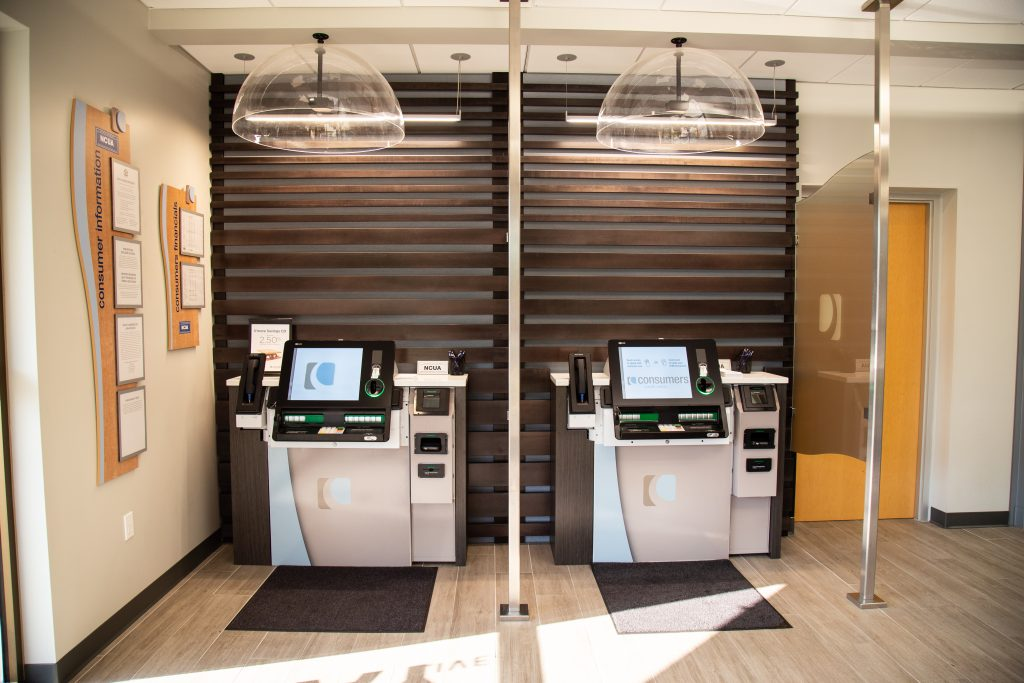 A front view of two self-service tellers in a Consumers Credit Union office