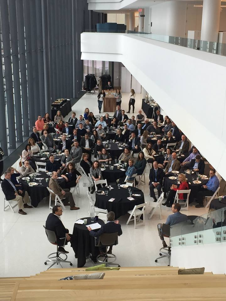 A view of a large meeting from the top of the Consumers Credit Union headquarters