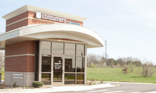 An outside view of a Consumers Credit Union office on a sunny day