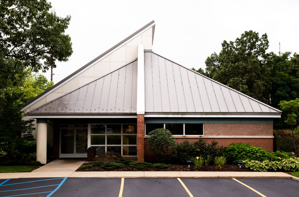 A Consumers Credit Union office with a slanted roof