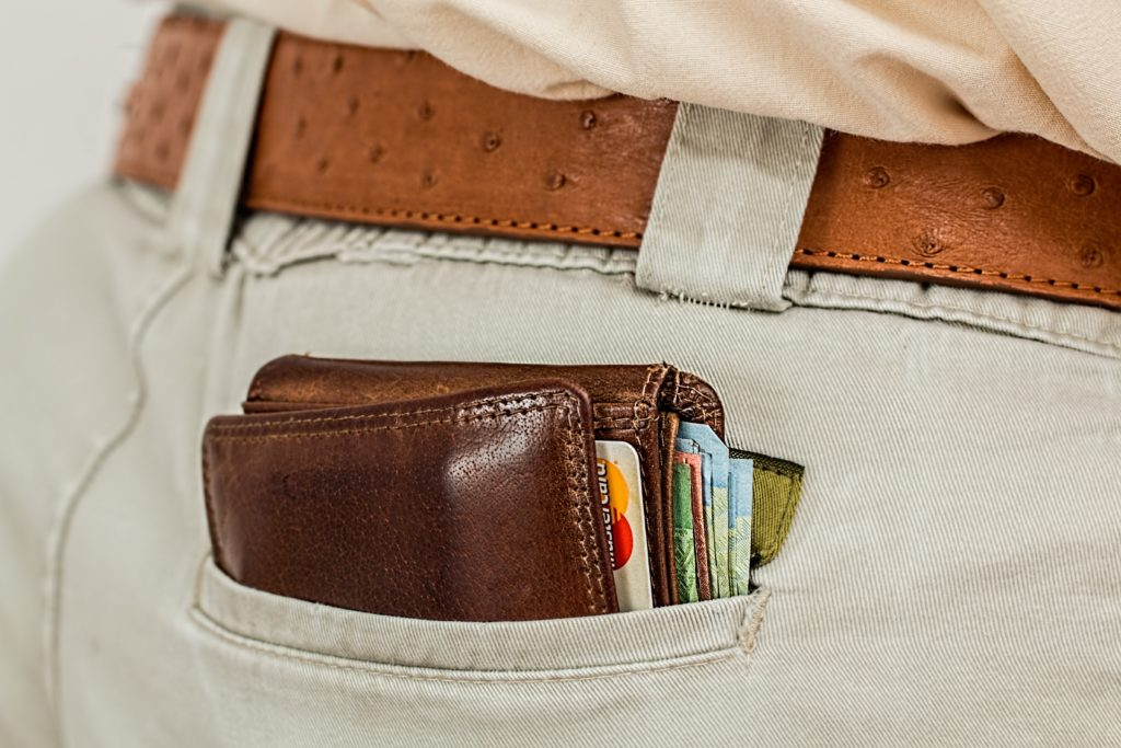 Close-up of a man's wallet sticking out of his back pocket