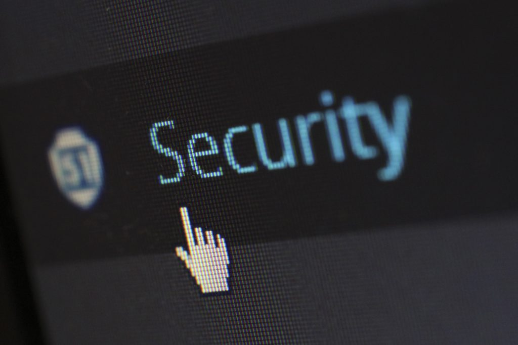 Mouse pointer on a computer screen pointing to the word security
