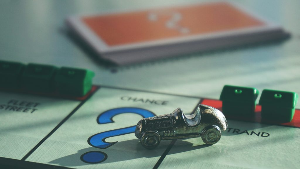 Close-up photo of Monopoly car token landing on the chance square