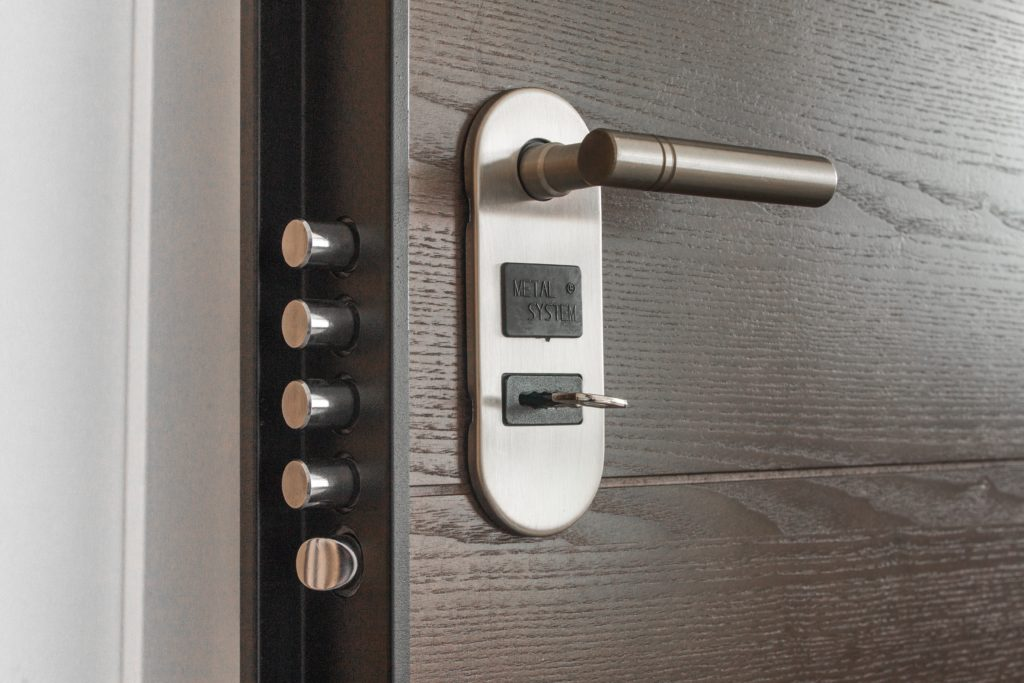 Closeup of a door showing the handle, keyhold and deadbolts
