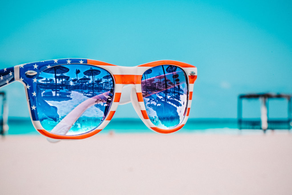 American flag sunglasses with sea in the background