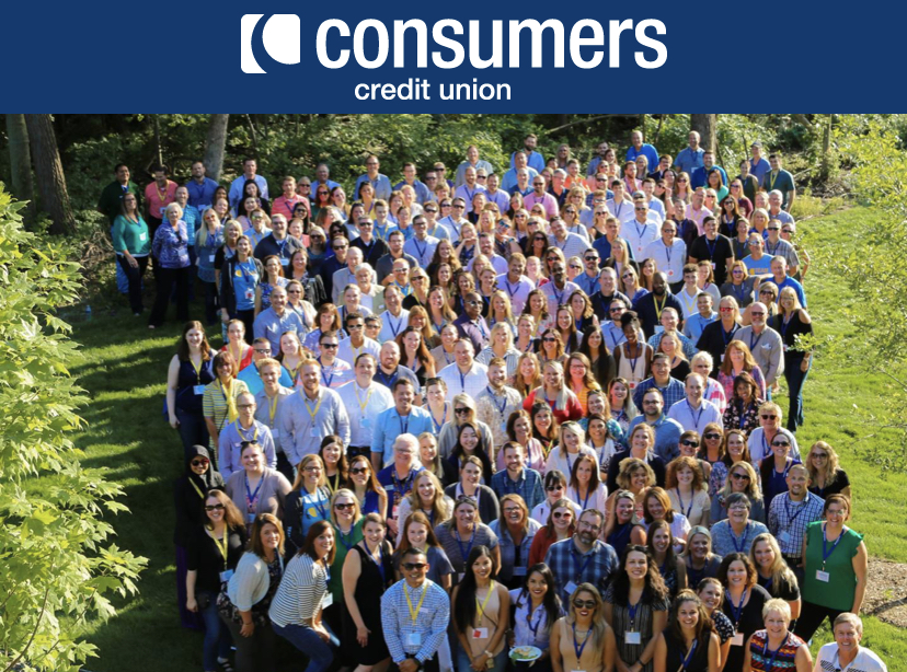 the consumers credit union employees stand for a picture