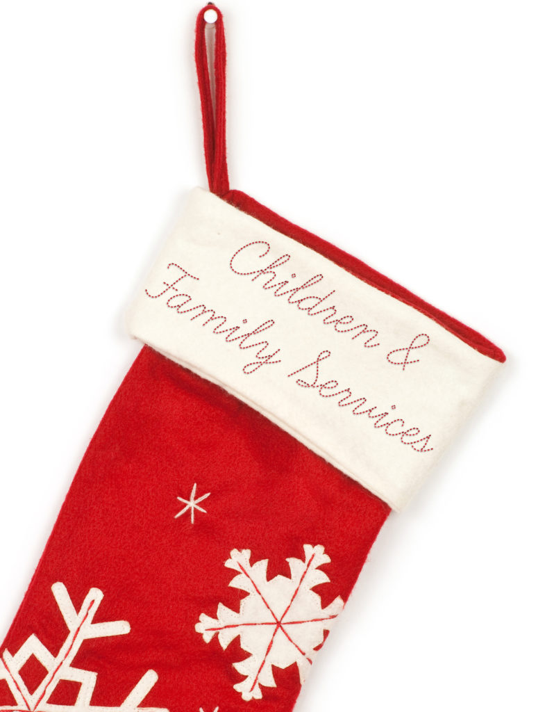 Red Christmas stocking with shadow on white background