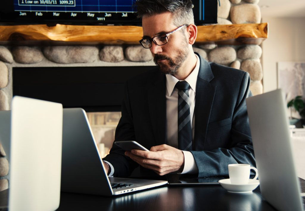 Businessman working on his laptop and mobile phone