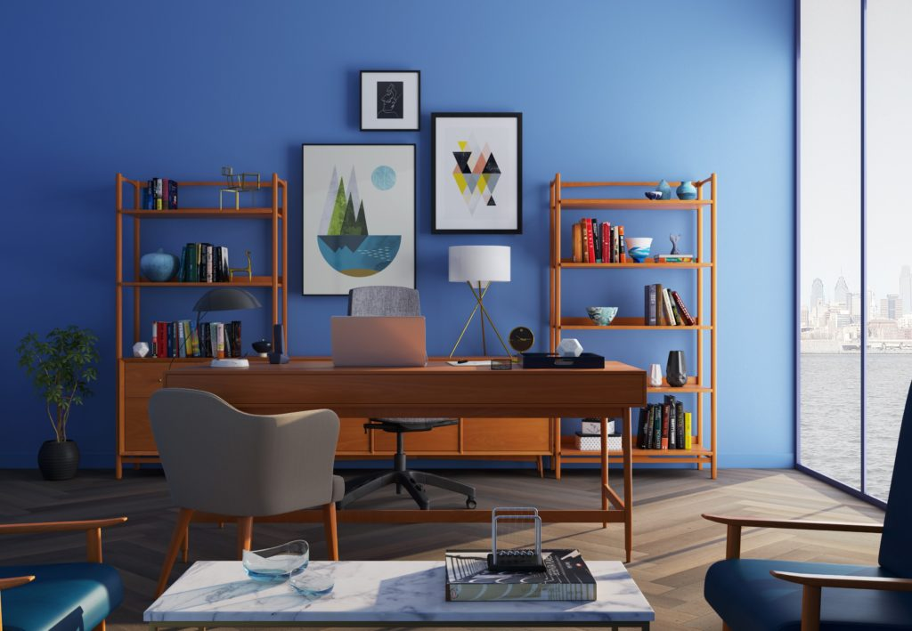 An executive office setting with a bright blue wall.