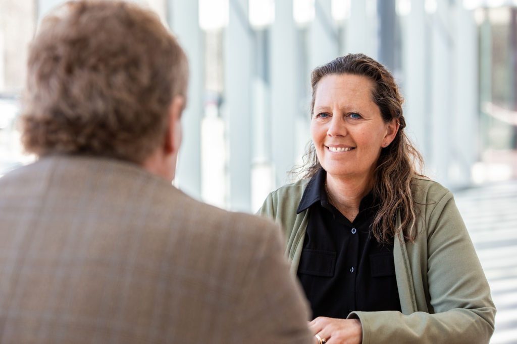 Sandy Bloem, Consumers Credit Union Business Development Manager in a conversation with a client.