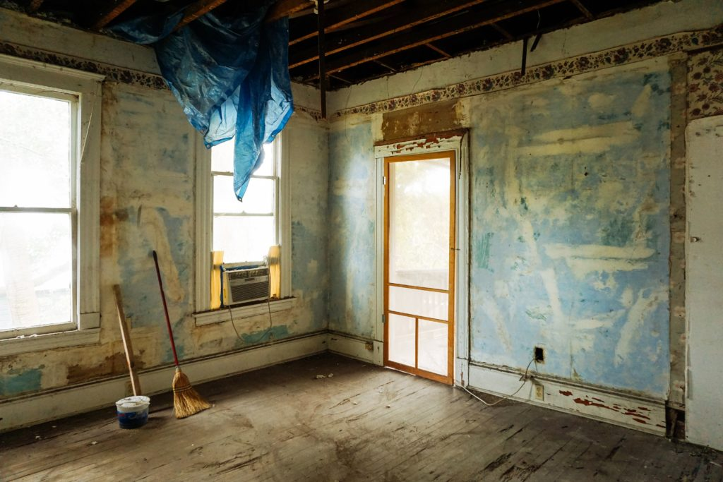 Interior of house stripped to floor and drywall