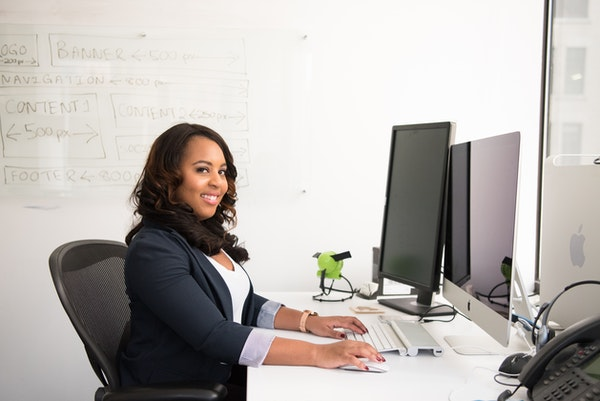 Black businesswoman working on a computer