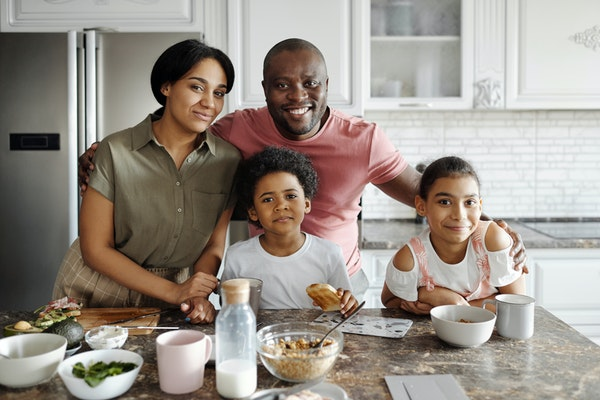 Smiling family in a white kitchen