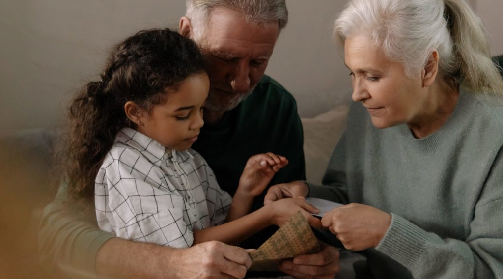 Older couple with granddaughter