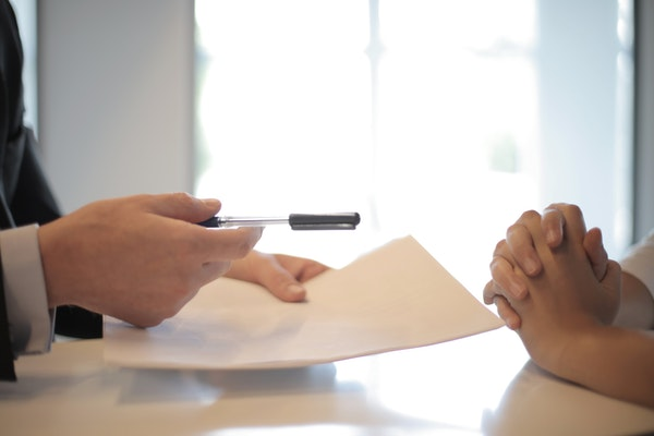 Person signing a loan document