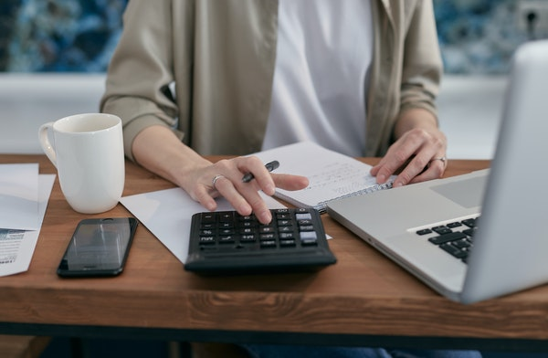 Woman working at desk on budgeting