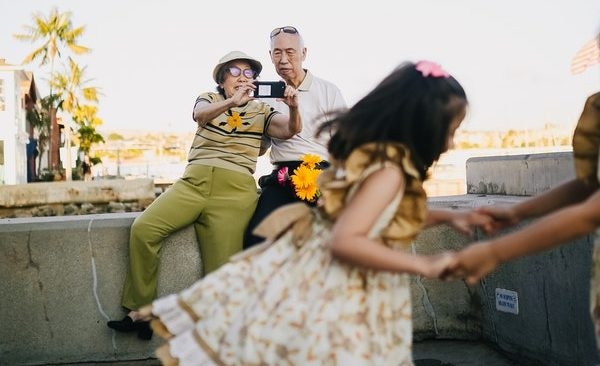 older couple photographing granddaughters